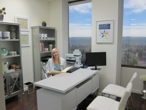 Cynthia at desk at Well With Nutrition